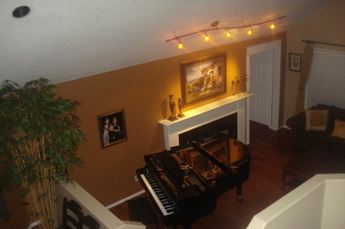 Living room with brand new grand piano